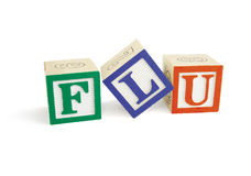 Blocchetti di alfabeto di INFLUENZA, inclinati L Immagine Stock Libera da Diritti