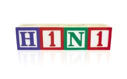 Blocchetti di alfabeto H1N1 con la riflessione Fotografia Stock Libera da Diritti