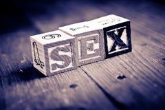 Blocchetti di legno del sesso Fotografia Stock Libera da Diritti