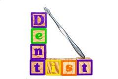 Blocchetti e spazzolino da denti del dentista Fotografia Stock Libera da Diritti