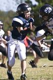 Blocchetto del giocatore di football americano della gioventù Fotografie Stock Libere da Diritti