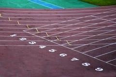 Blocchetto iniziare del circuito dell'atletica leggera Fotografia Stock