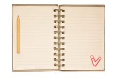 Blocchetto per appunti in bianco con la matita ed il paperclip Fotografia Stock