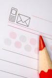 Blocchetto per appunti con la matita rossa fotografia stock libera da diritti