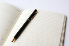 Blocchetto per appunti con la penna Fotografie Stock Libere da Diritti