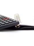 Blocchetto per appunti e calcolatore fotografie stock