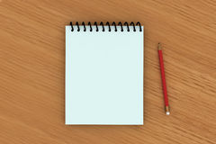 blocchetto per appunti e una matita rossa su w Fotografia Stock
