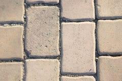 Blocchi in calcestruzzo, blocchi stradali, pianterreno Fotografie Stock