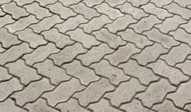 Blocchi di blocchi di pietra grigi per la pavimentazione dei marciapiedi Fotografie Stock