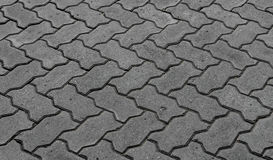 Blocchi di blocchi di pietra grigi per la pavimentazione dei marciapiedi fotografia stock