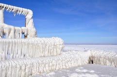Blocchi di ghiaccio su un pilastro Fotografie Stock