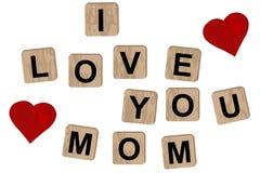 Blocchi di legno che compitano l'iscrizione ti amo sulla mamma royalty illustrazione gratis