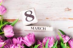 Blocchi di legno con la data di Giornata internazionale della donna, l'8 marzo Fotografia Stock Libera da Diritti