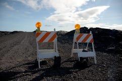 Blocchi stradali sulla strada a flusso di lava di Kalapana Fotografia Stock Libera da Diritti