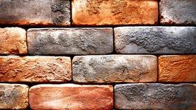 Blocchi strutturati arancio di parete di mattoni per la decorazione Immagini Stock
