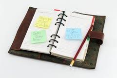 Blocco note con il Post-it circa successo Fotografia Stock Libera da Diritti