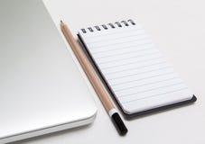 Blocco note e penna Fotografia Stock