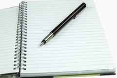Blocco note e penna stilografica immagini stock libere da diritti