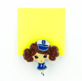 Blocco note giallo con la clip della ragazza della marina Fotografia Stock Libera da Diritti