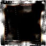 Blocco per grafici del grunge di Filmstrips Immagine Stock