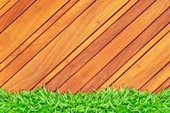 Blocco per grafici dell'erba su legno Fotografia Stock Libera da Diritti