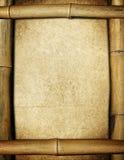 Blocco per grafici di bambù con il documento dell'annata Fotografia Stock Libera da Diritti