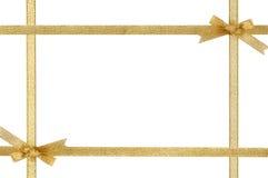Blocco per grafici di festa con i nastri e gli archi dell'oro Immagini Stock