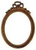 Blocco per grafici di legno dello specchio del vecchio oro ovale con gli ornamenti Fotografia Stock