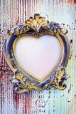 Blocco per grafici vuoto dell'annata nel modulo di un cuore Fotografie Stock