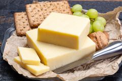 Block of aged cheddar cheese, the most popular type of cheese in. United Kingdom and USA, natural cheese made from cow milk stock photography