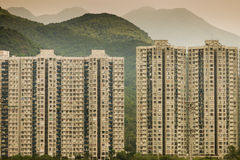 Block of buildings on hill in Hong Kong. In front of Horse Race Center Stock Photography