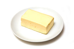 Block of butter on plate Royalty Free Stock Photography