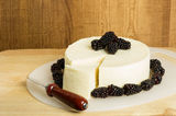 Block of cheese with blackberries Royalty Free Stock Photography