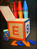 Block and Crayons. Words Love spelled out infront of block box royalty free stock photo