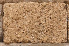 Block des Tuffs auf Wand des mittelalterlichen Palastes Stockbilder