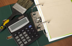 Block of documents with calculator and paintbrush Royalty Free Stock Image