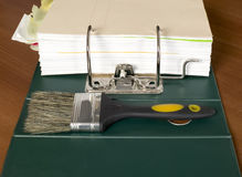 Block of documents with paintbrush Stock Photo