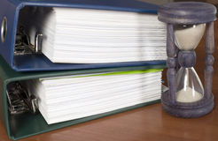 Block of documents with sand clock Royalty Free Stock Image