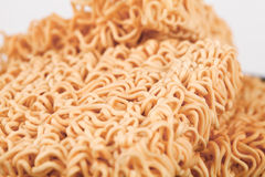 A block of dried Instant noodles. On gray background paper Stock Images