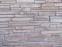 Rough, uneven block wall 2a. A block filled, rock wall of uneven design outside during the day stock images