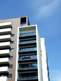 Block of flats. Modern block of flats on blue sky background Royalty Free Stock Photography