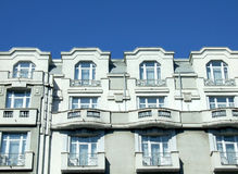 Block of flats. Old block of flats on blue sky in Bucharest, Romania Stock Images