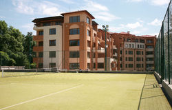 Block of flats. With tennis court royalty free stock images
