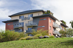 Block of flats. Modern block of flats or apartments unit in a urban real estate stock images