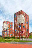 Block of flats. On the blue sky royalty free stock photo
