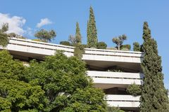 Block of flats in Athens - Trees and plants royalty free stock images