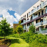 Block of flats in beautiful public park Royalty Free Stock Image