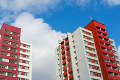 Block of flats. Blocks of flats made during era of socialism in eastern bloc. Cheap social housing for poor people today. Facade of architecture has bright red Royalty Free Stock Photos