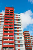 Block of flats. Blocks of flats made during era of socialism in eastern bloc. Cheap social housing for poor people today. Facade of architecture has bright red Royalty Free Stock Photo