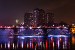 A block of Flats a Bridge and The River Clyde at night royalty free stock images